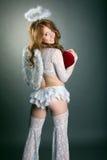 Le den sexiga ängeln som poserar på kameran Royaltyfri Foto