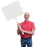 Le den skalliga mannen som rymmer ett tomt tecken, stiga ombord Royaltyfri Fotografi