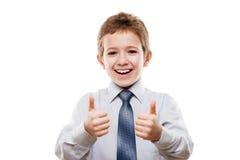 Le den unga affärsmanbarnpojken som gör en gest tummen upp framgång s Arkivfoton