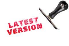Le DERNIER texte de timbre de VERSION avec la poinçonneuse photo stock