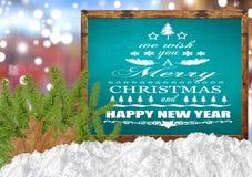 Le deseamos una Feliz Navidad y una Feliz Año Nuevo en azul en blanco Fotografía de archivo libre de regalías
