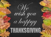 Le deseamos una postal feliz de la cita del diseño del día de la acción de gracias Imagen de archivo libre de regalías