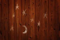 Le dessin de l'enfant de la lune et des étoiles sur le mur Photographie stock libre de droits