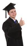 Le diplômé avec des pouces lèvent le signe Photographie stock libre de droits