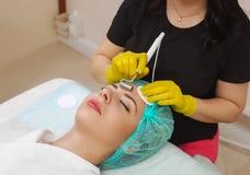 Le dispositif est cosmétologie faciale Image stock