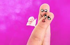 Le dita hanno dipinto le coppie dei biglietti di S. Valentino Immagine Stock