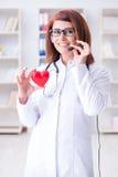 Le docteur de coeur dans le concept médical de télémédecine Photo libre de droits