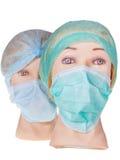 Le docteur fictif dirige le capuchon et le masque chirurgicaux s'usants de textile photographie stock libre de droits