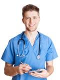 Le docteur prennent la note sur le presse-papiers image stock