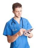 Le docteur prennent la note sur le presse-papiers images stock