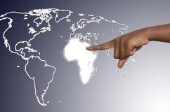 Le doigt touche l'Afrique Photos stock