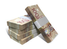 Le dollar canadien note la pile de paquets Photos stock