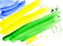 Le drapeau brésilien fait en coloré éclabousse Photos stock