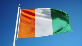Le drapeau de Cote Ivoire dans le mouvement lent a sans problème fait une boucle avec l'alpha clips vidéos