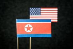 Le drapeau de la Corée du Nord et des Etats-Unis d'Amérique Etats-Unis Image stock