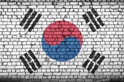 Le drapeau de la Corée du Sud est peint sur un vieux mur de briques illustration de vecteur