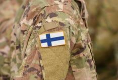 Le drapeau de la Finlande sur des soldats arment le collage photographie stock