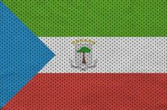 Le drapeau de la Guinée équatoriale a imprimé sur des vêtements de sport en nylon m de polyester illustration de vecteur