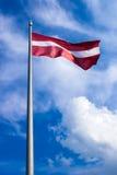 Le drapeau de la Lettonie Photographie stock libre de droits