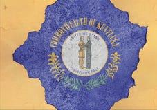 Le drapeau du Kentucky d'état d'USA a peint sur le trou concret et le mur criqué image stock
