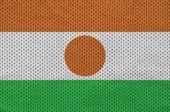 Le drapeau du Niger a imprimé sur un tissu de maille en nylon de vêtements de sport de polyester W illustration de vecteur