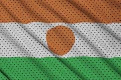 Le drapeau du Niger a imprimé sur un tissu de maille en nylon de vêtements de sport de polyester W photo libre de droits