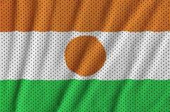 Le drapeau du Niger a imprimé sur un tissu de maille en nylon de vêtements de sport de polyester W images libres de droits