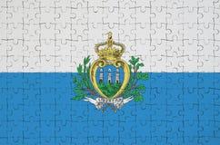 Le drapeau du Saint-Marin est dépeint sur un puzzle plié photo stock