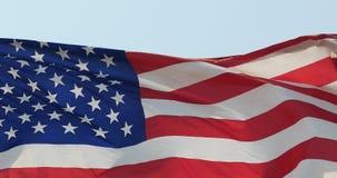 le drapeau 4k américain flotte en vent banque de vidéos