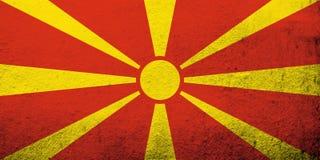 Le drapeau national de la république de Macédoine Fond grunge illustration libre de droits