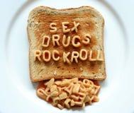 Le droghe del sesso oscillano il pane tostato del rullo Immagine Stock