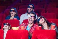 Le emozioni della gente nel cinema Immagini Stock