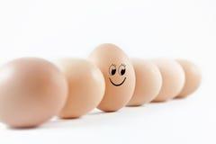 le för ägg arkivfoto