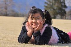 le för flickamalay Royaltyfri Bild