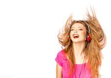 le för musik för flickahörlurar lyssnande arkivbilder