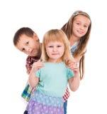 Le för tre gulligt barn Arkivfoto