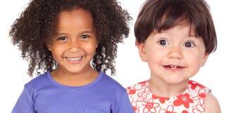 Le för två roligt små flickor arkivfoton