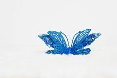 Le farfalle blu è un fondo bianco Fotografia Stock