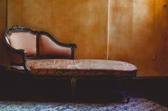 Le fauteuil de cru photos stock
