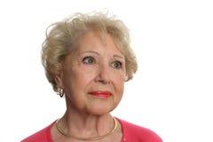 Le femme aîné fait face au contrat à terme incertain Images libres de droits