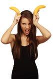 Le femme avec des bananes Photos libres de droits