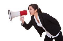 Le femme crie par un mégaphone Images libres de droits
