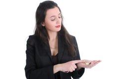 Le femme d'affaires compte l'argent Photographie stock