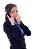 Le femme d'affaires s'inquiète au téléphone Photo libre de droits