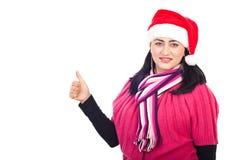 Le femme d'aide de Santa donnent des pouces Image libre de droits