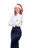 Le femme dans le chapeau de Santa pose photo libre de droits