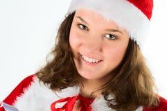 Le femme dans un procès Santa, souriant. Images libres de droits