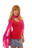 Le femme dans une écharpe rouge Photos stock