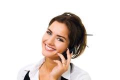 Le femme de sourire parlent du téléphone portable Image stock