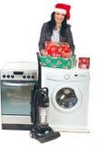 Le femme effectuent la promotion de Noël au ménage Photographie stock libre de droits